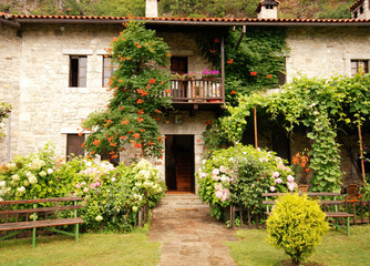 Colorful rural house with garden