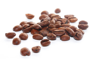 Brown coffee beans on the white background
