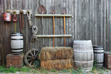 barrel bale and fork in old barn