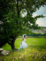 Bride in nature in a wedding dress