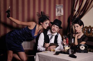 Gambling mafia type with cigarette, playing poker.