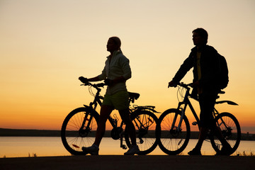 Couple of bicycles on sunset