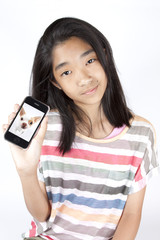 Asian teenage girl show smart phone with dog photo on.