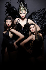 Three girls in a gothic style