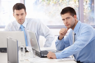 Young businessmen working at meeting table