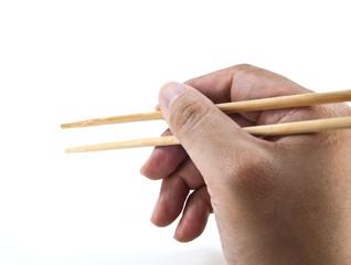 A hand using chopsticks