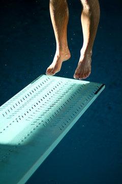 feet jumping on springboard