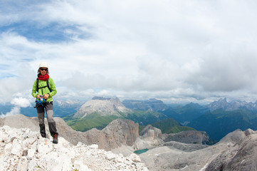 Mountain scenery with rock climber. Dolomites, Italy.