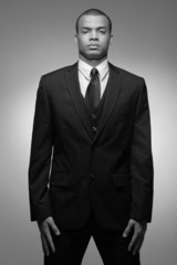 Young  African-American business man in black suit.