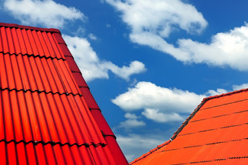 Red roof in the blue sky
