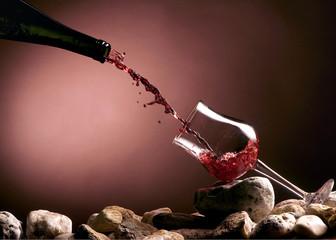red wine splash in a glass