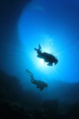 Divers on Scuba along reef