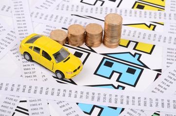 Receipts,coins and house with toy car