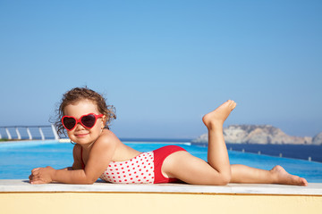 little  girl sunning at the pool