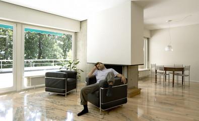 man in a modern armchair