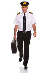 Airline pilot walking carrying flight case.