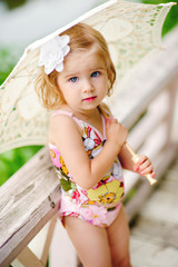 close-up portrait of beauty little girl with flower in her hair