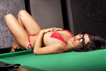 Sexy young girl on a pool table