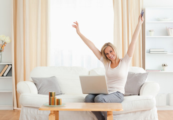 Cheerful woman buying online