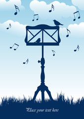 birds sitting on music stand