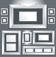 Symmetrical series of empty picture frames