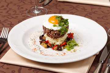 beef burger with egg and potatoes