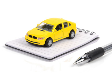 Toy car,pen and notepad