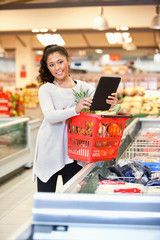 Shopper in store using digital tablet