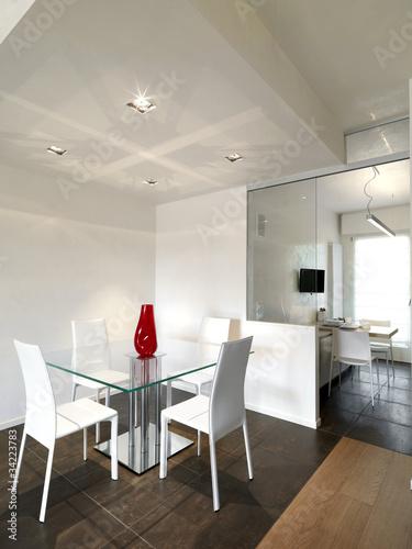 Sala da pranzo con tavolo quadrato e vista sulla cucina immagini e fotografie royalty free su - Tavolo da pranzo quadrato ...
