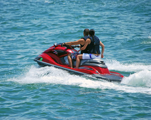 Boy and Girl and a Red Jetski