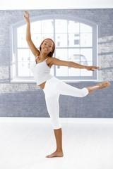 Happy ballet dancer in pose
