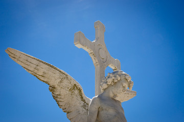 Angel against blue sky