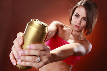 Fit brunette and a drink can
