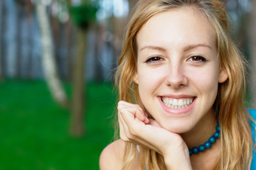 Smiling teenage girl at the park
