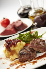 Beef steaks with vegetables