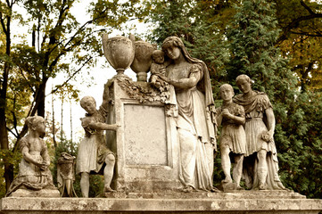 Tombstone family on a cemetery