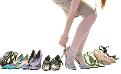 pretty young woman with buying shoes addiction, isolated on whit Wall mural