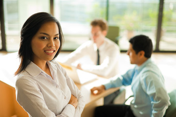 Attractive Asian Business Woman Stands Meeting