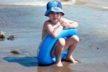 The boy plays n seacoast
