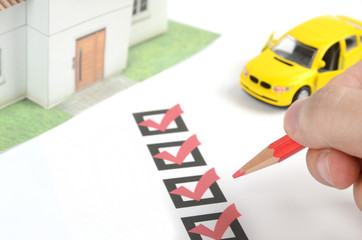 Check box and car with house