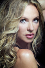 Attractive blond woman with long curly hair.