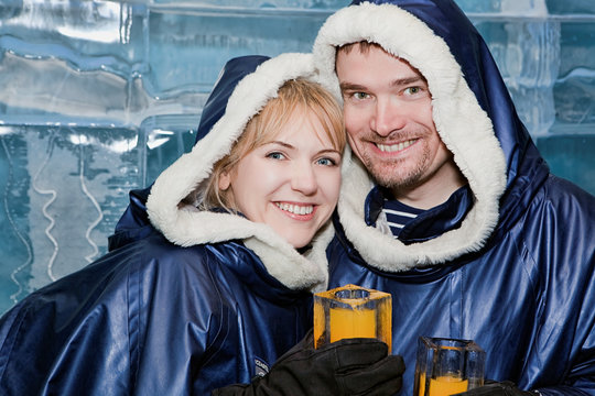 Happy couple having a drink in ice-bar