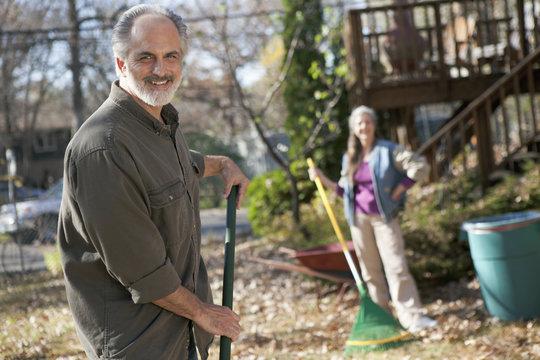 Mature couple doing yard work