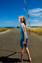 Child with a walking stick.