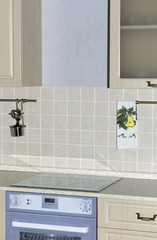 Bright interior with kitchen cabinets and wall tiles