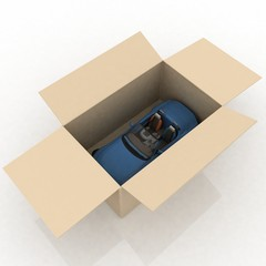 open box with inside a new car