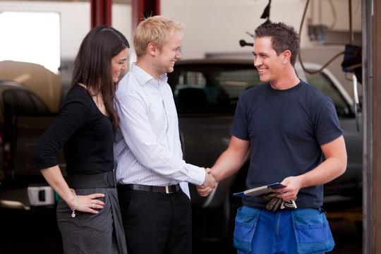 Mechanic with Happy Customer