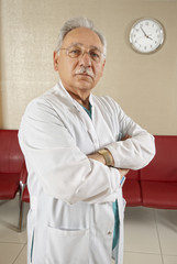Senior Doctor with Clock