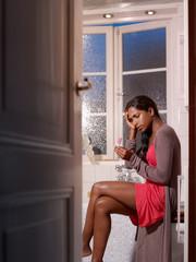 sad woman with pregnancy test kit