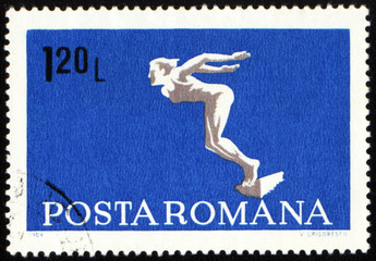 Diving swimmer on post stamp